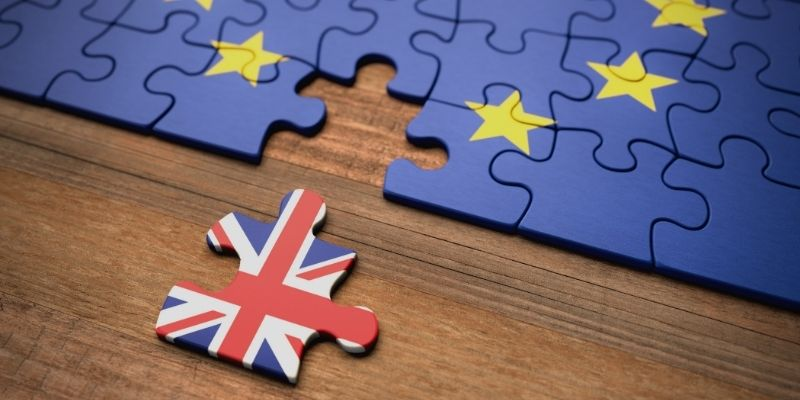 Image of a jigsaw with european flag and a union jack piece moved away to symbolise Brexit.